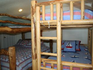 Midway condo photo - The log bunkbeds in the loft sleep up to 5. Queen mattress on bottom left.