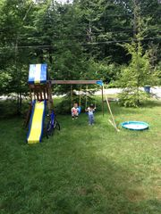 Tobyhanna house photo - Front yard with the slide and swings for kids. Two lounge chairs.