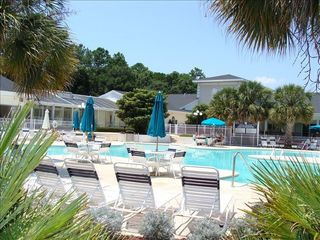 Sunset Beach condo photo - Outdoor pool with adjacent heated indoor pool