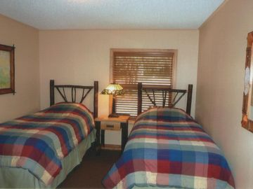 The Map bedroom - pair of twin beds, full bath across the hall.