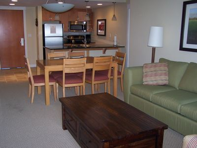 Spacious family area, with dining seating for nine at table and bar.