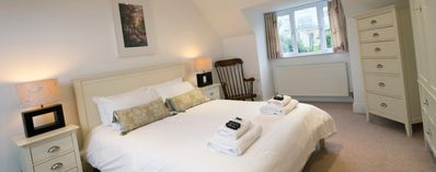 Top Master bedroom - king bed - sea views through skylight, and garden views