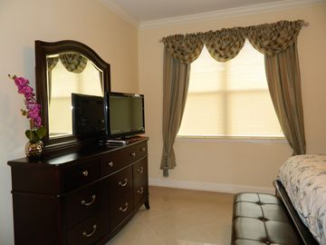 Queen bedroom with TV