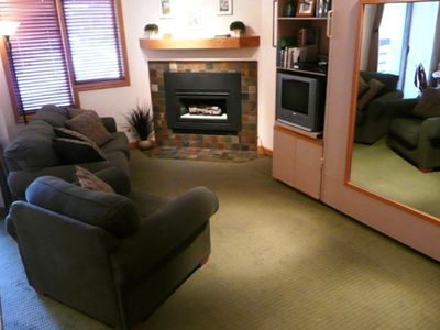 Living Room area with fireplace, DVD, VCR and full cable television
