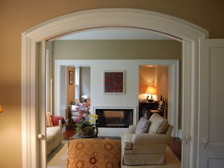 Bridgehampton house photo - arched pocket doors; bay window; three living rooms
