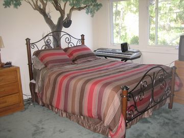Primary rental bedroom with queen sized bed and private full bath.
