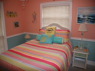 Anastasia Island house photo - Seashell room with queen bed and wicker furniture.