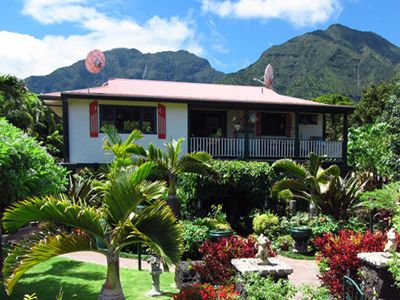 Hanalei house rental - An exterior view with a backdrop of majestic North Shore mountains & waterfalls