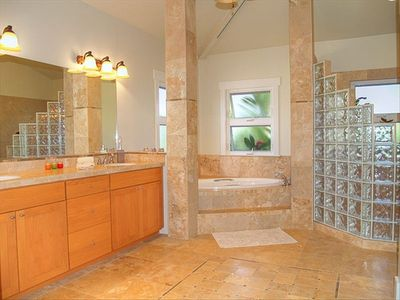 Master bathroom with jacuzzi soaking tub, separate shower