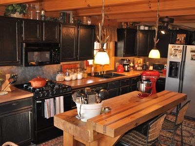 Harrison lodge rental - Entertain Your Guests in the Well-Equipped Kitchen/Bar Area