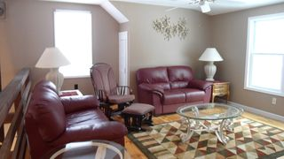 Orleans house photo - Family/TV Room in Loft with two leather loveseats and rocking chair.