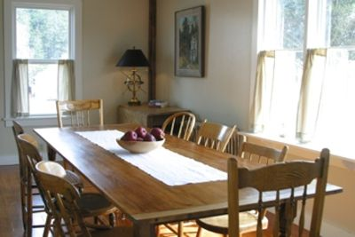 Farmhouse Table has views of Harbor and Village and seats 8 comfortably.
