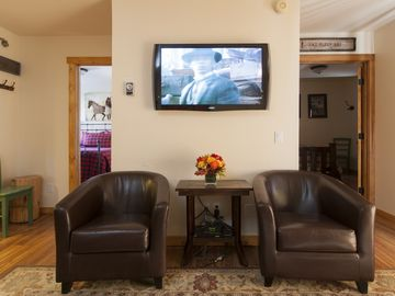 Living room with 42 inch HD/LCD TV and DVD Player.