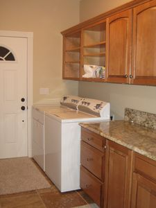 Complete laundry room with washer & dryer.