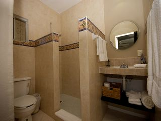 Playacar condo photo - Luxurious tiled bathroom.