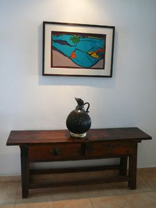 A mix of modern and antique art and furniture
