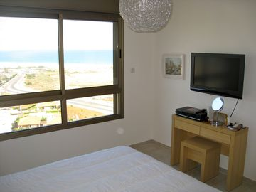 Master bedroom sea view, and flat screen TV