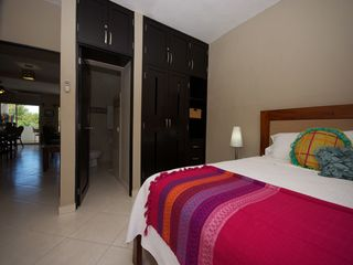 Playacar condo photo - Master bedroom with king bed and en suite bathroom.