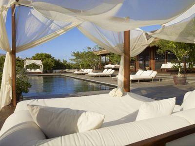 Donna Karan's Sanctuary at Parrot Cay   Day beds surrounding the infinity pool