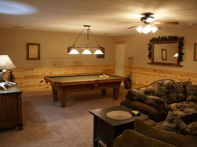 The large family room features an 8' slate pool table