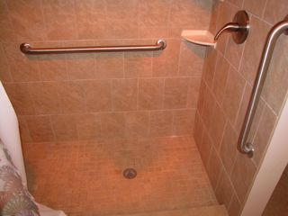 Sunnyside condo photo - Master bath has large tiled walk in shower.