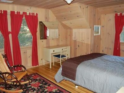 queen bedroom upstairs with a lakeview