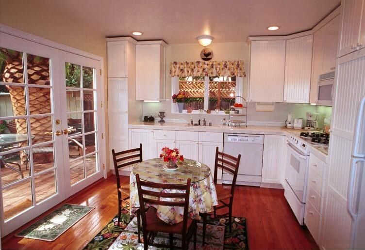 Large, bright kitchen opens onto the garden