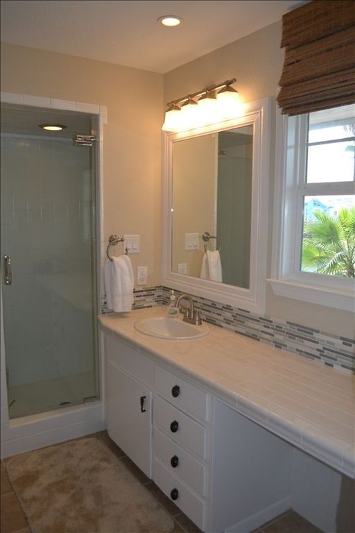 Newly renovated en suite Master Bath with view of the canal.