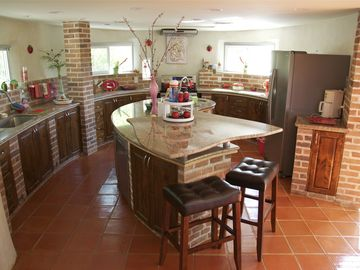 Kitchen, island, granite countertops, stainless steel appliances