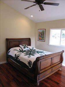 Garden room with Cherry Wood Queen bed and tiger wood floors.