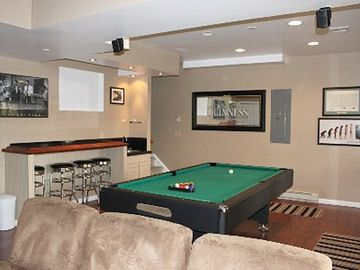 Great lower level with pool & ping pong, bar & TV area