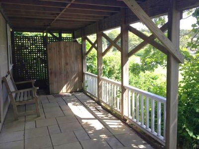 Shaded patio and outdoor shower at lower cottage-upper one has same facilities.