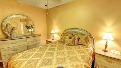 Indian Rocks Beach condo rental - Master bedroom featuring a queen size bed, full closet and flat screen TV.