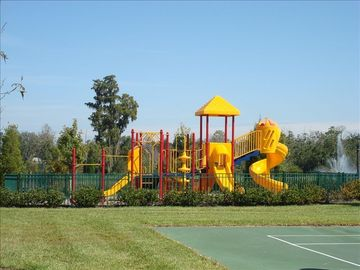 Play structure near volleyball, basketball and tennis courts