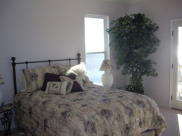Queen bed with pillow top materess. View the gulf from all widows in this room.