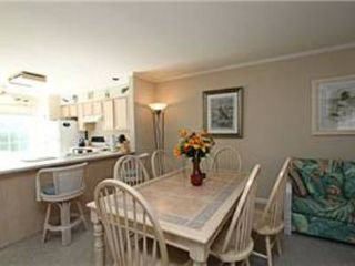 North Ocean City townhome photo - Dining Room table and view of Kitchen peninsula with the island and bar stools.