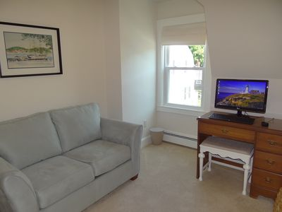Den with Computer and Wall Mounted TV
