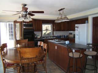 Gravois Mills house photo - Kitchen/Dining area, full lakefront view/washer-dryer-1/2 bath off this area(rt)
