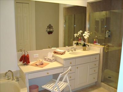 Spacious Master Bath with oval bathtub, 2 vanities and huge shower cabin