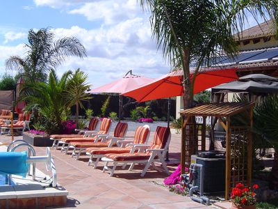Plenty of Sun Loungers & Sun Shades around Heated Swimming Pool, Mountain Views