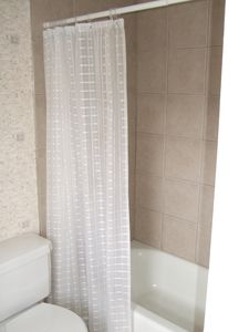 Bathroom with tile shower and tub