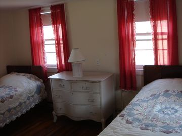 One Of The Bedrooms With Twin Beds