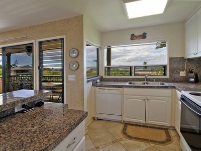 Spacious gourmet kitchen with same western view of the lanai