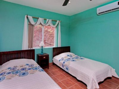 Playa Conchal condo rental - Guest bedroom with two twin beds