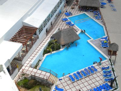 Your view of the pool and fun from your balcony! Sit & enjoy the views & breeze!