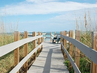 Walk right over the Dune and enjoy a Mile of Beach Front Acces