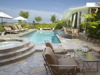Hollywood estate photo - Pool and outdoor entertainment seating areas and spa