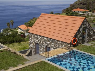 studio in traditional stone house with shared heated pool & wide ocean view