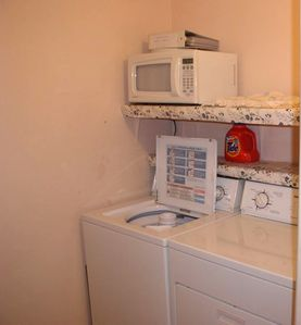 Separate utility room with Full Size Washer and Dryer!