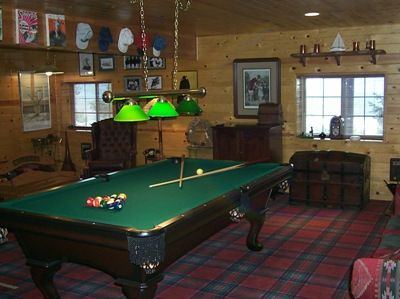 Game room with pool table and player piano